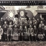 Ching-ling (front row, centre) as a top-ranking leader of the Nationalist party when it was at its most Leninist in March 1927. To her right: Sun's son, Fo; to her left: her brother T.V. and Eugene Chen (next to T.V.). Mao Ze-dong, later supreme leader of Communist China, is in the middle row, third from right. Deng Ya-da is in the back row, third from right. The backdrop is a portrait of Sun Yat-sen, flanked by the flags of the Nationalist party and of Nationalist China.