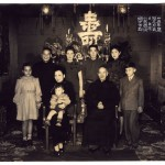 Chiang Kai-shek's family celebrated his birthday in Nanjing, 1946. (The big character in the background – shou – means 'longevity'.) He and May-ling are seated; Chiang's two sons stand behind them: Ching-kuo (left); Wei-go, (third from left). Between them is Ching-kuo's wife, Faina Vakhreva; the couple had met and married in Russia when Ching was kept there by Stalin as a hostage. Their four children are also in the picture, with a toddler on May-ling's lap.