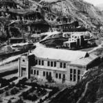 Yenan: the building constructed specially for the Party congress that enthroned Mao in 1945.  Cave dwellings visible in the background, dug into the soft loess hills.