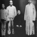 Mao Tse-tung (right), in the only photograph of him with his mother, taken in Changsha in 1919, shortly before she died.  Mao, aged twenty-five, is dressed in scholar's garb, while his two younger brothers, Tse-t'an (far left) and Tse-`min, are still wearing peasant clothes.
