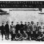 "Mao (standing, third from left, looking Oscar Wilde-ish) in his post-Long March HQ, Yenan, September 1937, with some of the participants in the ""Autumn Harvest Uprising"" of 1927, the founding movement of the myth of Mao as a peasant leader.  His third wife, Guiyuan, is standing right."