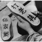 Painting slogans on the soles of 'liberation shoes' during the civil war - 'Safeguard Our Land' (left) and 'Beat Chiang Kai-shek'.