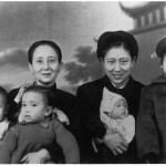 My grandmother holding me (aged two with ribbons in hair) and Jin-ming; my mother holding Xiao-hei, Xiao-hong standing.  Chengdu, late 1954.