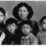 My mother with (from left) Xiao-hong, Jin-ming, Xiao-hei, and me, Chengdu, early 1958.  This photograph was taken in a hurry for my father to bring with him to Yibin to show his mother, who was gravely ill.  Signs of haste show in my mother's hair, which has not been brushed down, and in the handkerchief still pinned (as was customary for young children) to Jin-ming's sailor suit.