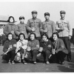 On Tianamen Square, Peking, as a Red Guard (front, second from left), with friends and air force officers (including one woman) assigned to train us.  I am wearing a Red Guard armband, my mother's 'Lenin jacket', and patched trousers to look 'proletarian'.  We are all holding the Little Red Book in a standard posture of the time.  November 1966.