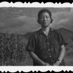 My mother in her camp at Buffalo Boy Flatland, in front of a field of corn she helped plant, 1971.
