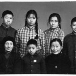 On the eve of being expelled to the edge of the Himalayas (standing second from right); with (standing from left): Jin-ming, Xiao-hong, and Xiao-hei; front row (from left): my grandmother, Xiao-fang, and Aunt Jun-ying; Chengdu, January 1969.  The last photograph of my grandmother.