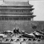 A caravan of camels passing in front of a Beijing city gate.  It was said that some five thousand camels came into Beijing every day.