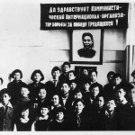 "Mao's two surviving sons at the special school for children of foreign Communist leaders at Ivanovo, outside Moscow.  An-ying, the eldest son, is the tall boy in the middle row, centre.  The banner above the portrait of Mao reads: ""Long live the Communist International - the Organiser of the Struggle for the Victory of the Workers!"""
