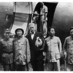 In August 1945 when Japan surrendered, Stalin told Mao to go to Chongqing to play the negotiating game with Chiang Kai-shek.  Mao in topee on arrival at Chongqing, with US Ambassador Patrick Hurley (centre).  Chou Enlai to right of Hurley.