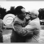 Post-Stalin Soviet supremo Nikita Khrushchev was willing to help turn China into a military superpower, which was Mao's long-cherished dream.  The two leaders embrace at Peking airport in August 1958.  Interpreter Li Yueron on the left.